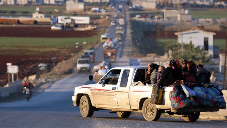Displaced Syrians who fled the fighting in Idlib province drive on a road in a rebel-held area near the city of Saraqib on Jan. 7, 2018. (Omar Haj Kadour / AFP/Getty Images)