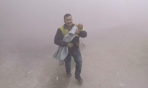 """Running from the hell of another warplane airstrike,  # WhiteHelmet   Saeed, grips the only thing that suddenly matters to him in this world, his baby boy Ibrahim. The latest victim of the ferocious strikes on  # Saqba   city in E.Ghouta.""  – via Twitter"