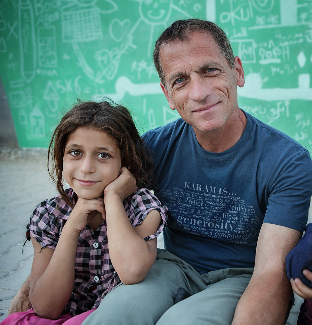 "Mohamad Ojjeh  serves on the board of Karam Foundation as the Executive Director of Documentation & Smart Aid Coordinator. A Syrian American from Damascus, he says that working with refugees changed his life: ""I look at things differently, I appreciate what we have and think about the hundreds and thousands of people that we helped through Karam Foundation; we are changing lives every day and that's the least that I can do to make a difference in somebody's life."" He lives in Boston and volunteers with local youth soccer teams, coaching, filming, and photographing sport events for teams in his community."