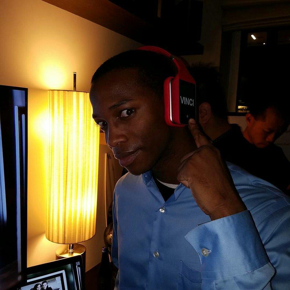Justin trying the Vinci Headphones.