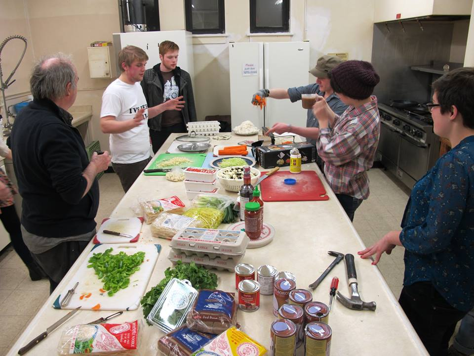 Free Radical Resident Curt Oren teaches Thai cooking before a music show.
