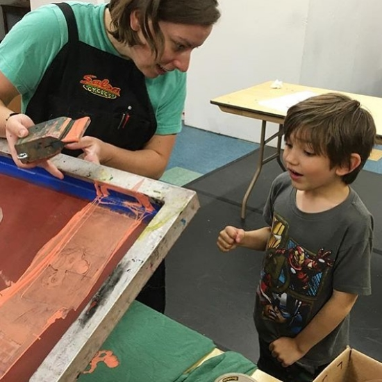 Gallery team and IC Press Co-op member, Chrissy Cooper, screenprinting an alterego with Leo during ICPC Superhero Gear camp (June 2016)
