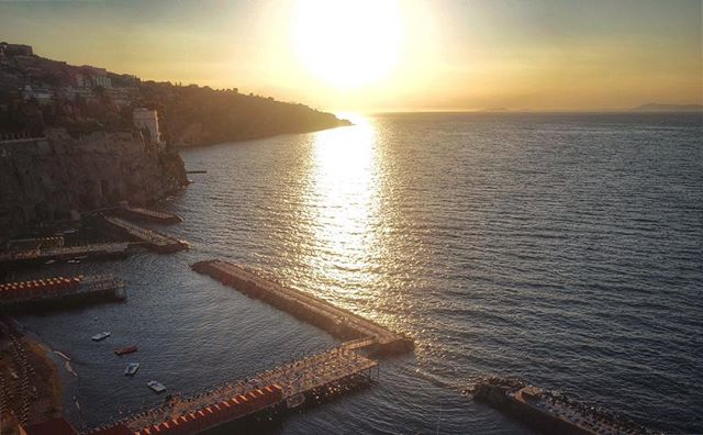 The sun getting ready to set over the bay of Naples. The piers down below are rows and rows of sun beds. There are also floating sun beds right on the water. Heaven.