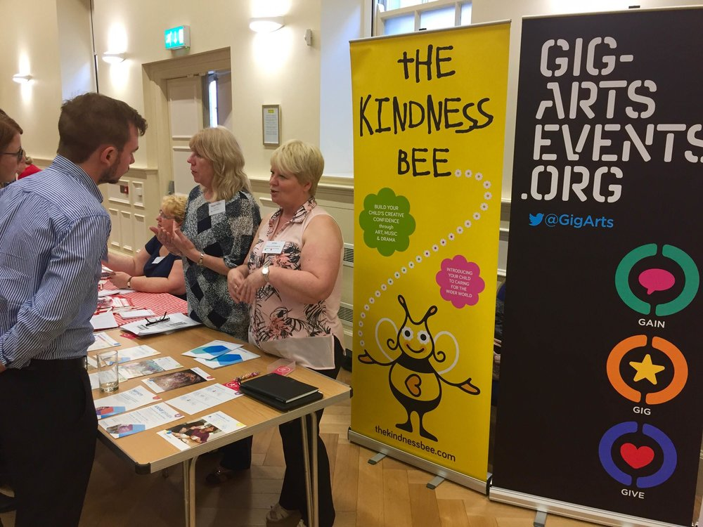 The Gig-Arts exhibition stand with Jill Bull, Gig-Arts Trustee