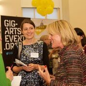 Abbie Cooke chatting with guests at the ROBIN Event