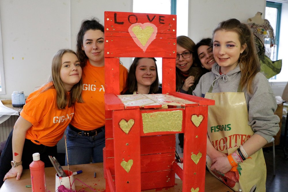 Performing Arts Students from the City of Oxford College creating colourful artworks to give to a local school.