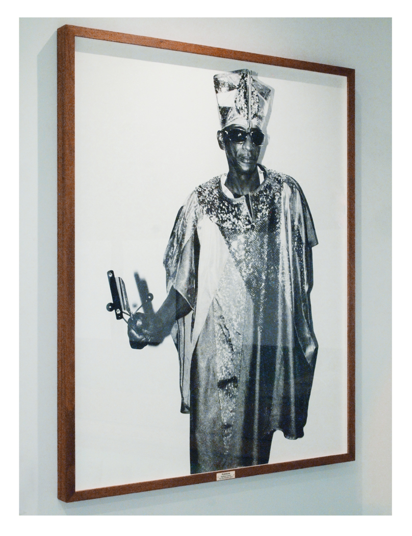 Portrait of Atakatune - Sun Ra Arkestra photographed in 2013 at The Barbican in an Oak Box Frame with an Ivorine Title Plaque