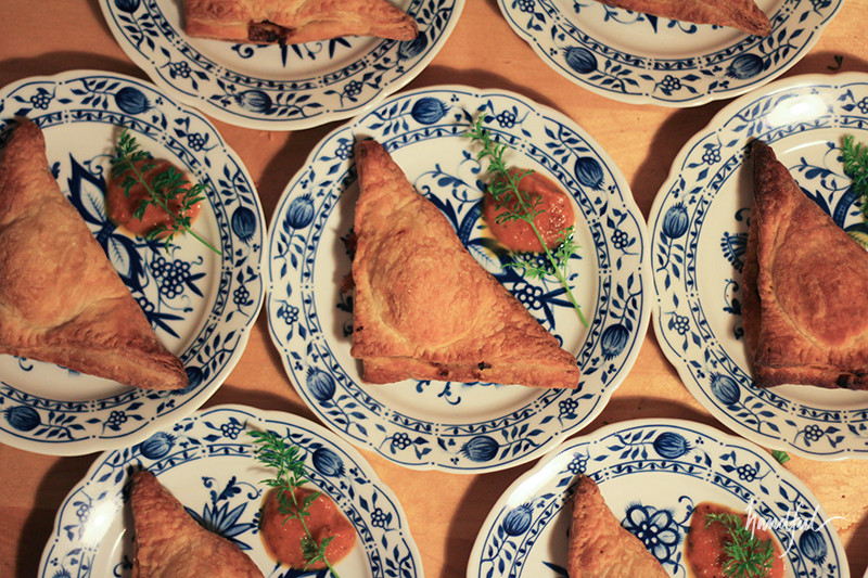 Karthik's egg puffs with homemade tomato sauce and homegrown carrot greens.