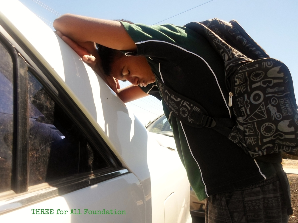 Some of the young people we work with are entirely disengaged from school or any other formal education. In this photo, one participant acts out an incident that contributed tothe disengagement of another participant (the photographer) - there's no petrol in Mum's car and no money to buy petrol, so it's impossible to get to school on time.