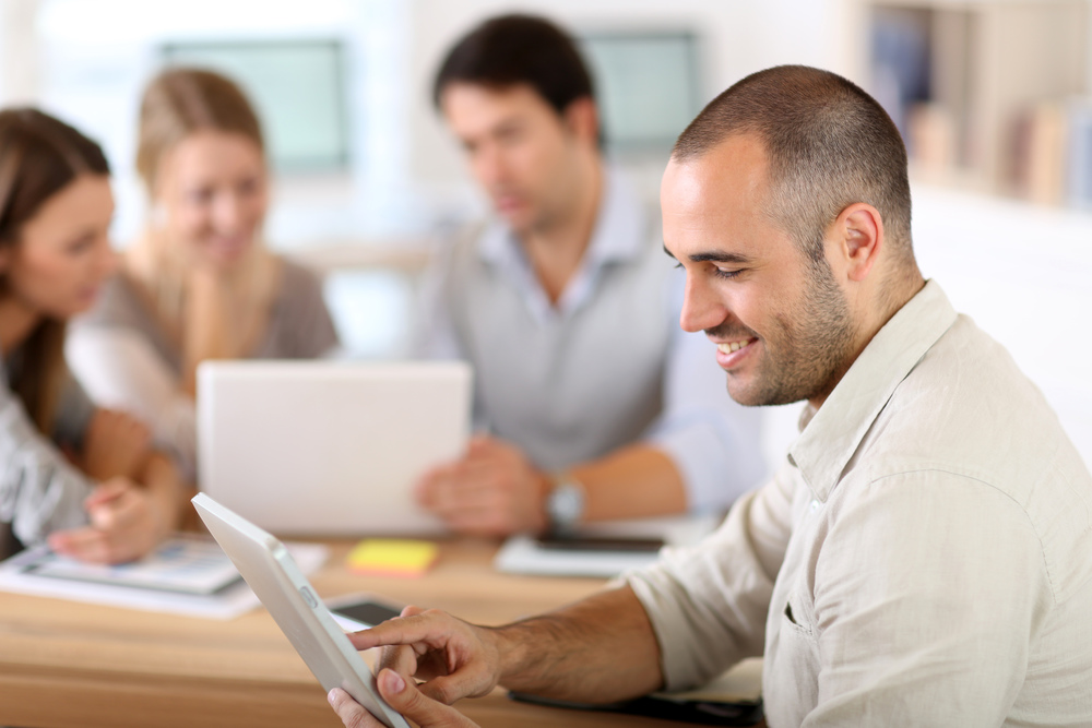 stock-photo-young-man-using-tablet-computer-144401359.jpg