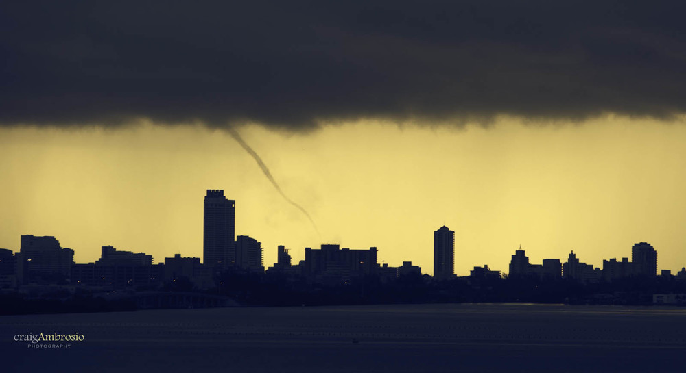 A very cool site to see a waterspout over Miami Beach, FL this morning.