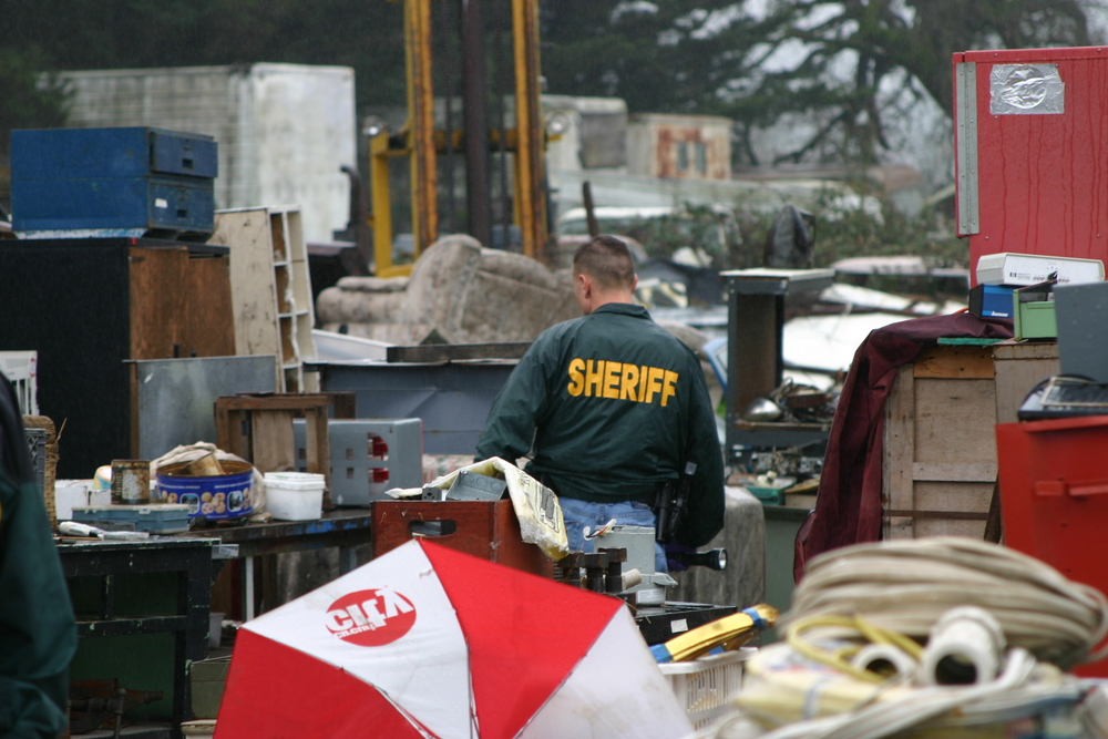 Deputy conducts a warrant search.