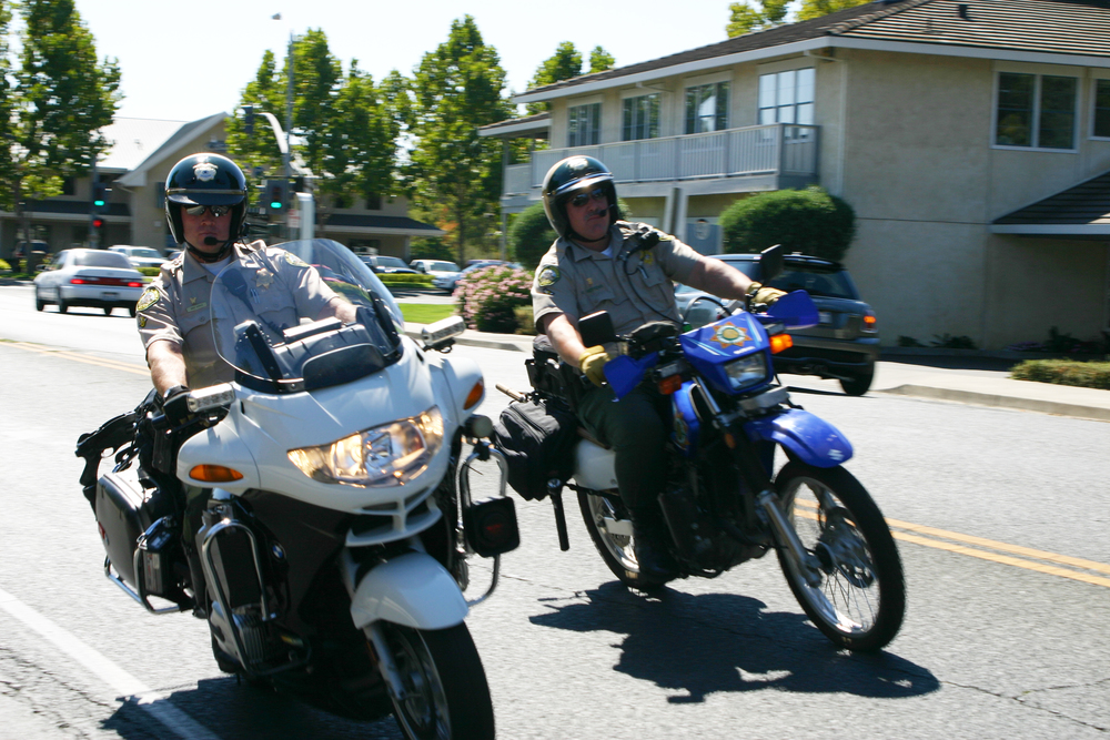 Contract city motorcycle deputies patrol the city streets.