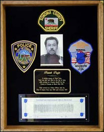 Photograph of Trejo memorial dedicated by and residing at the Lompoc Police Department.