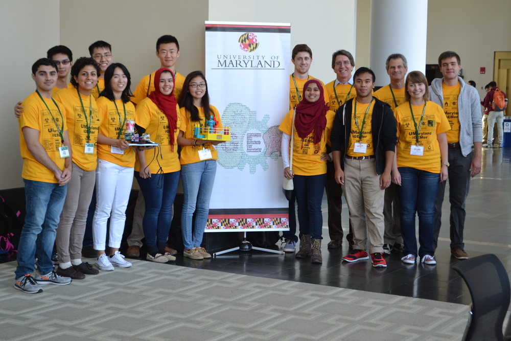 UMaryland iGEM'ers win gold again!!! Student researchers from around the world gather yearly for the International Genetically Engineered Machine competition (iGEM). This high-intensity event engages student-led teams from major universities worldwide to design, work on, and present novel synthetic biology projects that address real-world problems. The University of Maryland iGEM team, which is composed of 16 multidisciplinary students, including 13 ILS students, and 2 faculty advisors, traveled to the iGEM Jamboree in Boston from September 24-28, 2015, competing and collaborating with 250 teams from around the world.  Building on last year's success, UMaryland iGEM was awarded another gold medal, for approaches to accelerate the construction of new biodesigns.  The team's new method for plasmid maintenance without the use of antibiotics and the construction of an inexpensive thermocycler using parts from a hairdryer also earned one of five nominations for best new application.  The team developed the projects, performed laboratory research over the summer, conducted an extensive study of human practices related to the project, developed a Wiki page that described the project, raised $25,500 for lab supplies and travel costs, and presented a poster and an oral presentation at the competition.  The team is currently recruiting team members for the 2016 iGEM competition.  Go Terps!!!
