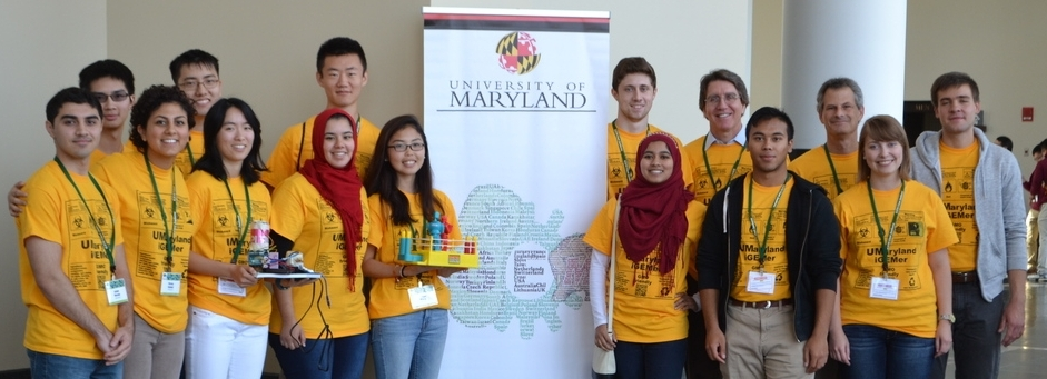 iGEMs student team at their national competition with Dr. Ed Eisenstein and Dr. Jason Khan.