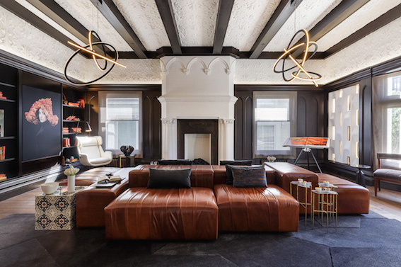Modern lighting, exposed beams, ornate fireplace... there's so much to love here.  Image source.