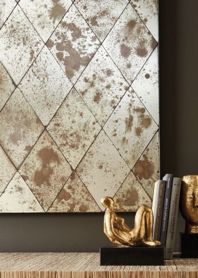 Antiqued mirror with a modern presentation. No traditional gilded frames here.    Image source  .
