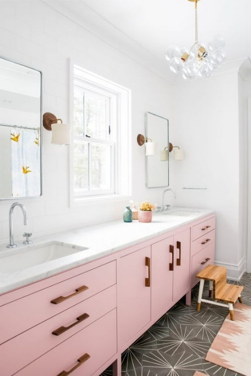 This gorgeous bathroom by the ever talented    Courtney Bishop Design   ! Love this fun patterned tile on the bathroom floor.