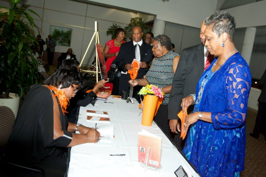 Dr. Bullock signing copies of her book