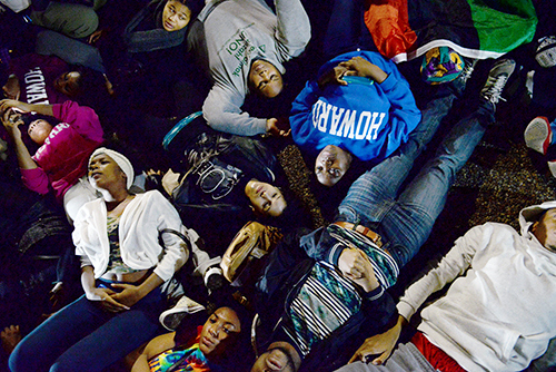 Students from George Washington and American, Howard and Georgetown universities lied on the ground in front of the White House in protest of the grand jury decision.  The GW Hatchet Samuel Klein | Senior Photo Editor