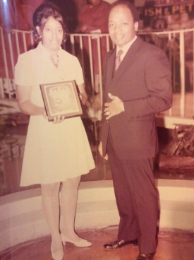 During the early days of ministry, Dr. Weptanomah Carter, w/ her husband Pastor Harold Carter, receiving the Baltimore Afro-American Newspaper Honor Roll Award for superior public service.
