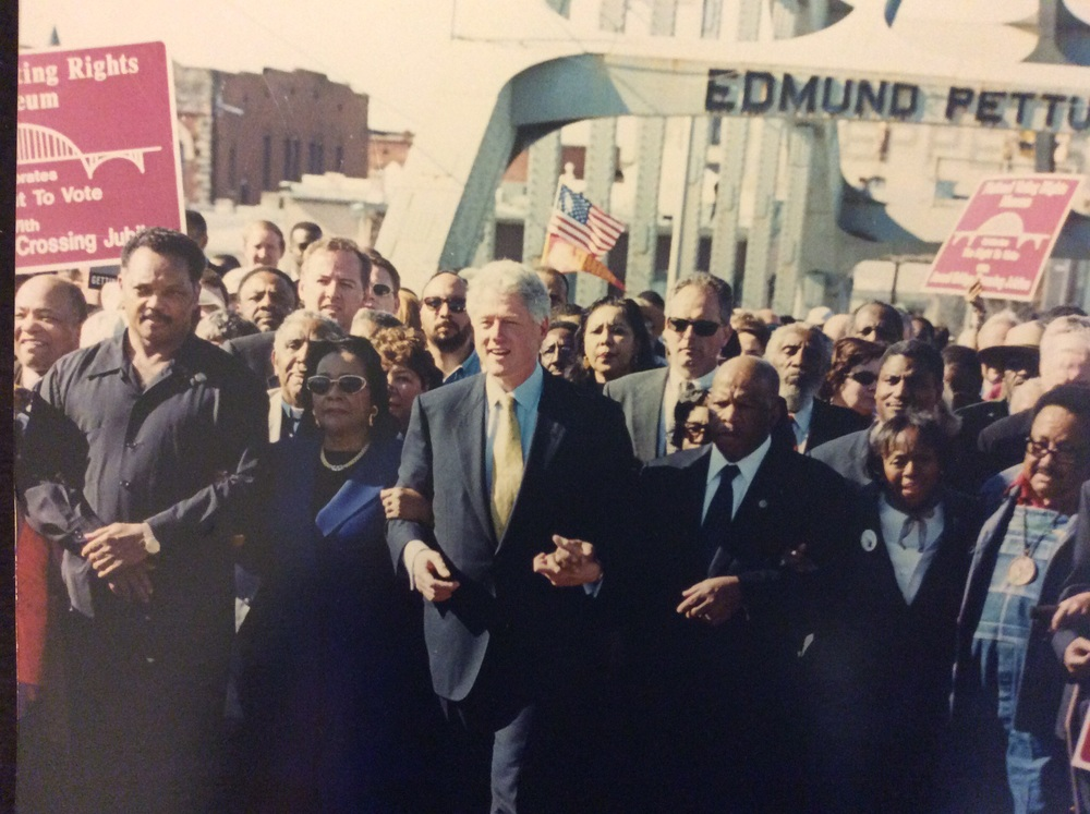 l-r, Dr. Harold Carter, Sr., Rev. Jesse Jackson, Sr., Rev. Joseph Lowery, Mrs. Coretta Scott King, President Bill Clinton, Rep. John Lewis, marcher and Mr. Hosea Williams