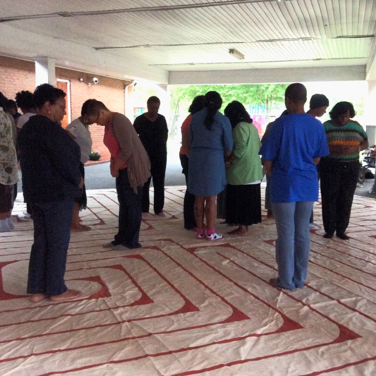Women in on the labyrinth in prayer & meditation in the breezeway