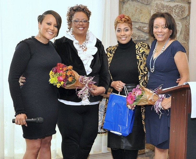 Lady Nakia Wright presenting flowers to Lady Mable Woodson Lady Kimberly McKissick and Weptanomah         photo: Bill Hart Photography