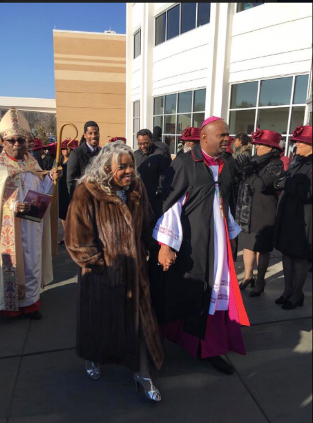 l-r   Bishop Walter S. Thomas , Lady Carla Debnam and Bishop Debnam preparing to enter the sanctuary  photo: Dr. Anthony Brown