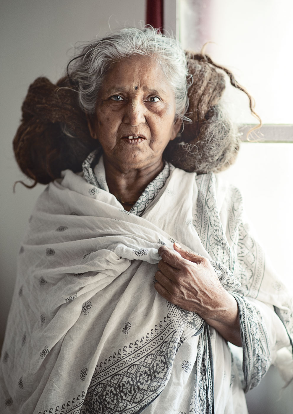 widow of vrindavan  by the window.jpg