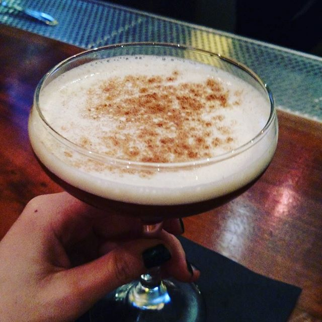 In honor of #Thanksgiving, come try a glass of Not Your Grandma's Pumpkin Pie: bourbon, amaretto, pumpkin ale, egg white, and spices. #yum #alameda #cocktail #drink #bayareadrinks