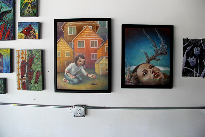 Jenn Hale's oil paintings flanked by Anna and Sherry's.