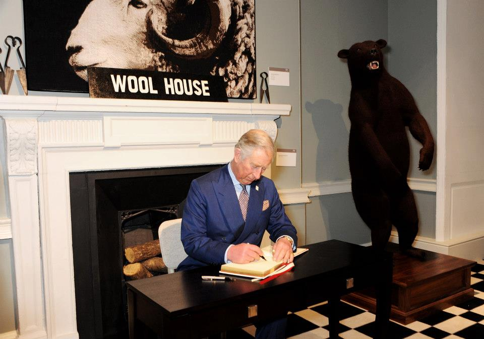 HRH Prince Charles signing the register under the watchful eye of Relentless the Ram.
