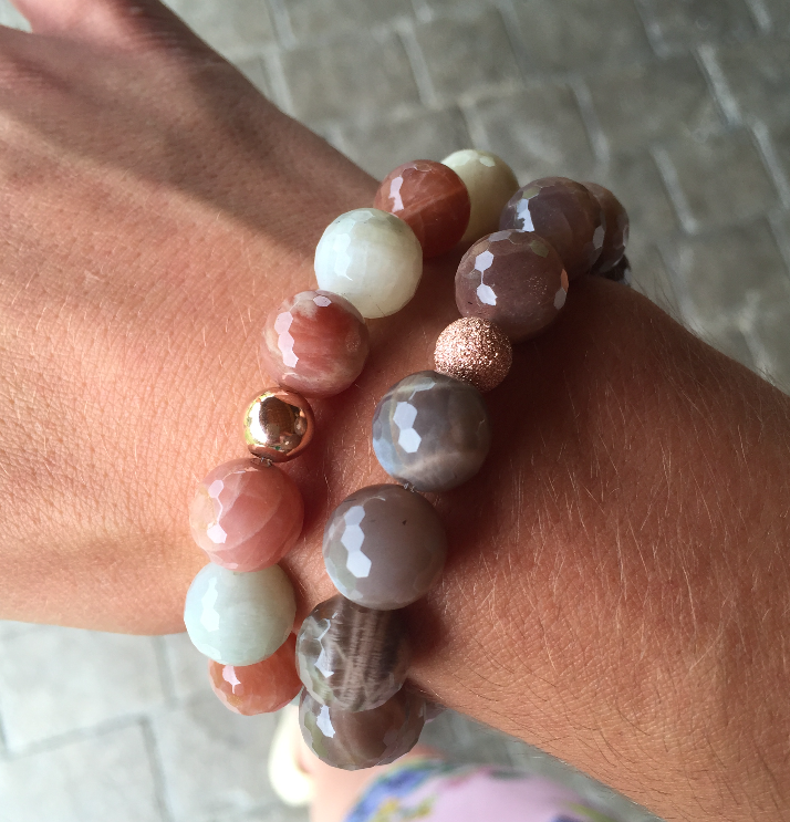 Lepidolite bracelets, from left, Pink and White & Tan