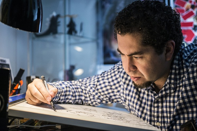 Hector Rodriguez draws in his studio in McKinney. Photo by: Can Turkyilmaz
