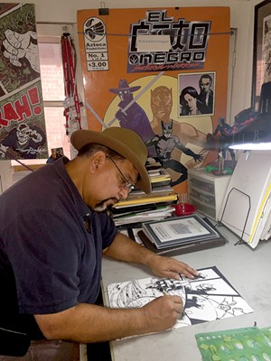 Richard Dominguez works on a comic in his studio. Photo by: Danny Gallagher