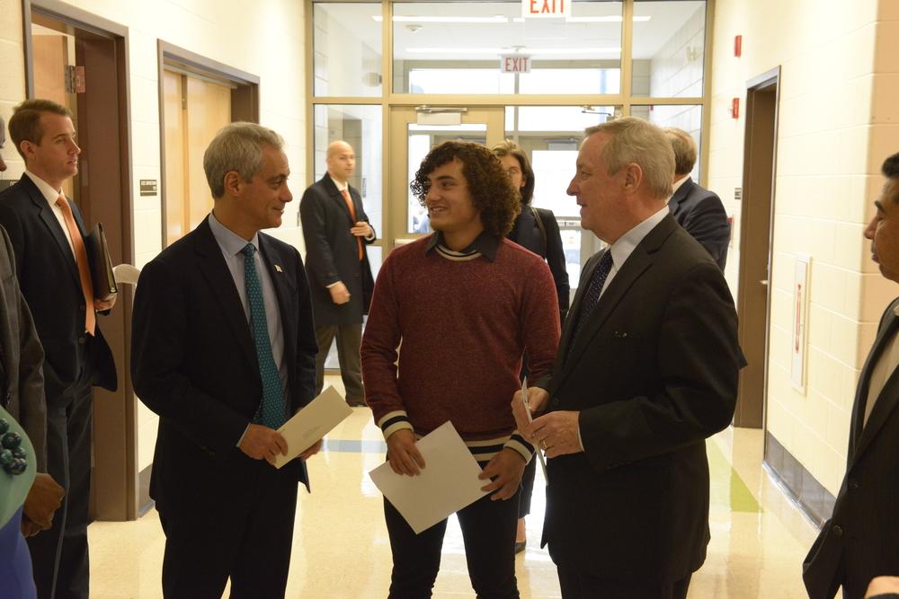 A Benito Juarez student ambassador greets Mayor Rahm Emanuel and Senator Dick Durbin