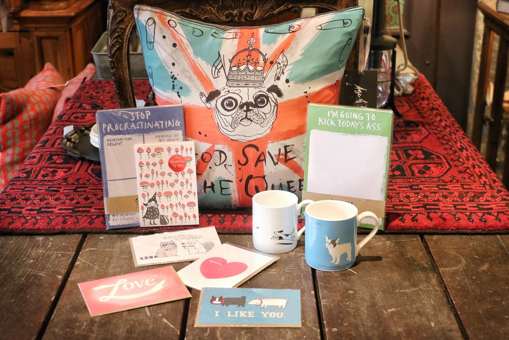 Pug hand Printed silk pillow $125, Bone China dog mugs $25, and all cards $5 each.
