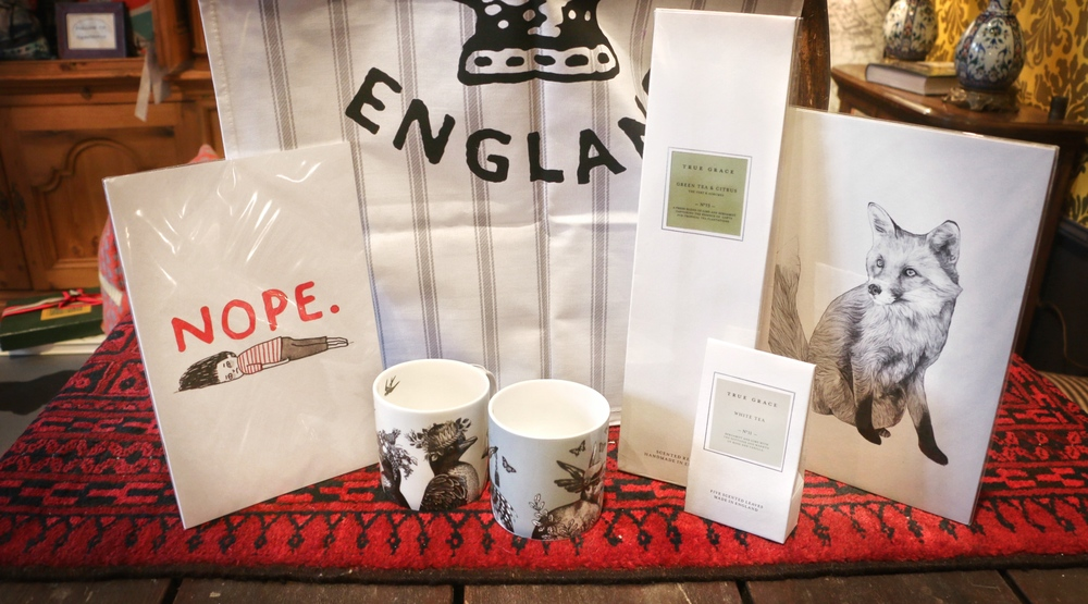 "Bone China mugs $28, ""Nope"" notebook $9.95, True Grace scented reeds $69, True Grace scented leaves $29, Fox print $29."