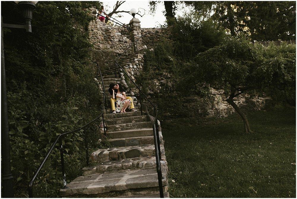 huntington-sunken-gardens-engagement-photo-couple-sitting-on-staircase-indiana-wedding-photographer