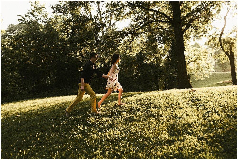 huntington-sunken-gardens-engagement-photo-couple-running-up-hill-sunset-indiana-wedding-photographer