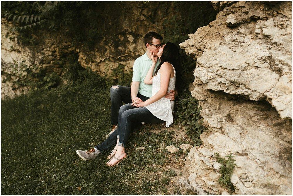 huntington-indiana-sunken-gardens-engagement-photo-couple-climbing-rocks-wedding-photography