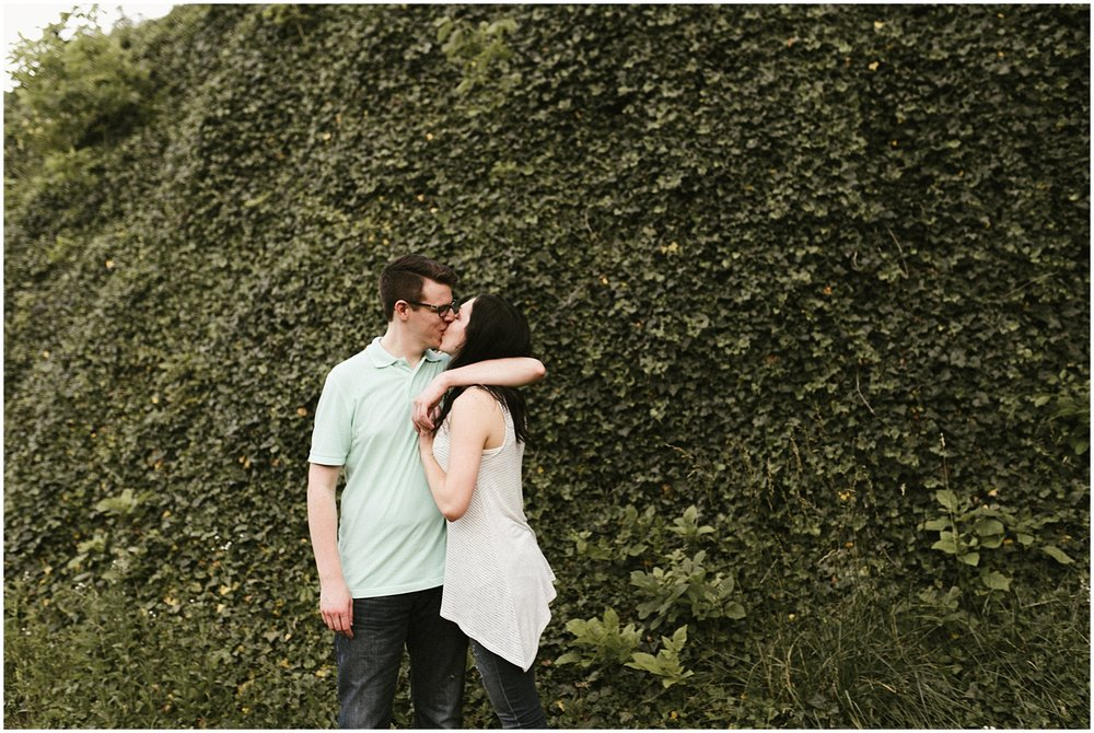 engaged-couple-poses-by-ivy-huntington-sunken-gardens-indiana-wedding