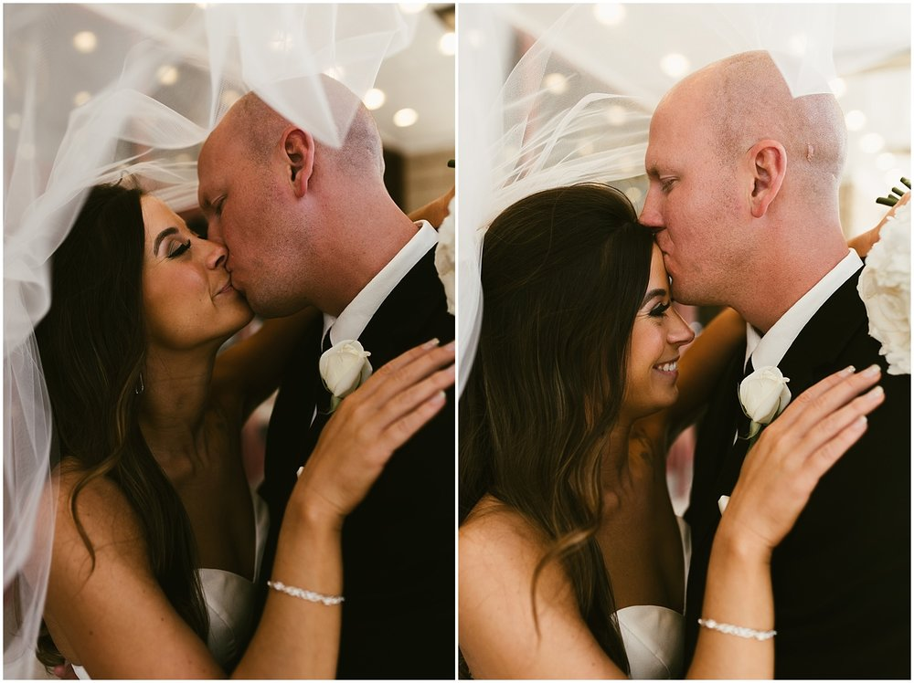 bride-groom-smiling-kissing-embassy-theatre-lobby-romantic-wedding