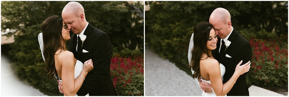 downtown-fort-wayne-wedding-bride-groom-embracing-indiana-photographer-8