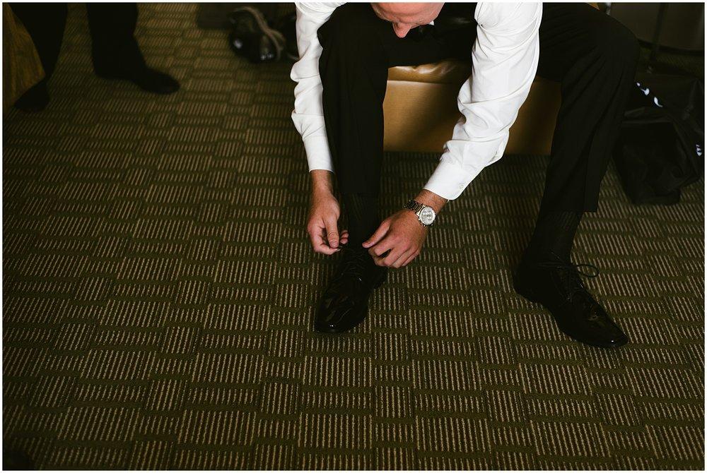 groom-tying-shoes-embassy-theatre-wedding-fort-wayne-indiana-photographer