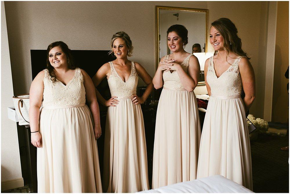 bridesmaids-smiling-champagne-dresses-hilton-hotel-fort-wayne-indiana-wedding-photographer