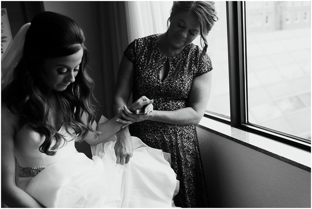 bride-and-mother-holding-hands-getting-ready-hilton-hotel-fort-wayne-indiana-photographer