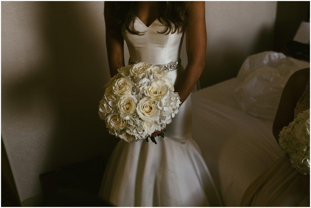 bride-holding-bouquet-hilton-hotel-fort-wayne-indiana-wedding-photographer